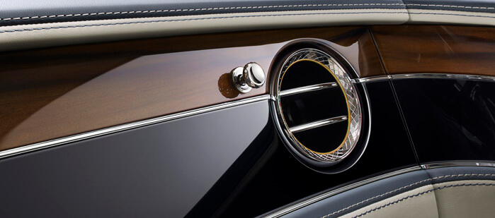 bentley-new-flying-spur-interior-front-dual-veneer-and-diamond-knurled-bullseye-vent-699x309.jpg